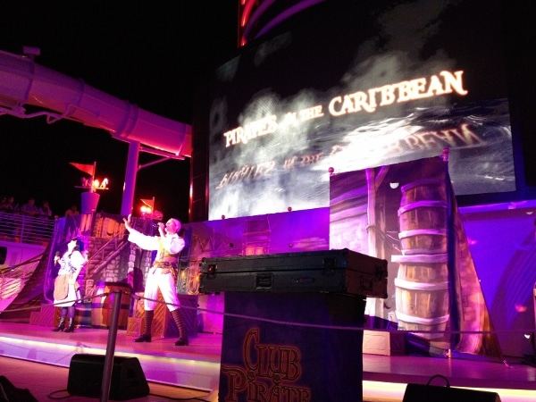 a Pirates in the Caribbean stage show at night on the pool deck