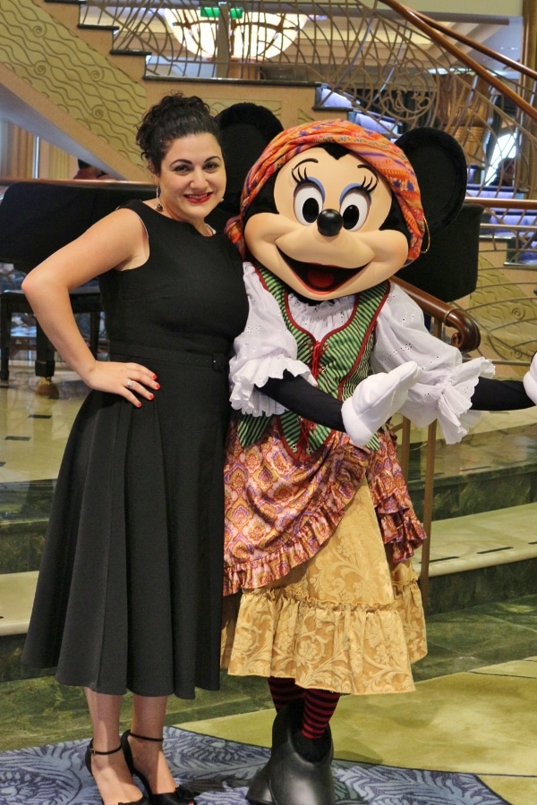 a woman posing with Minnie Mouse dressed as a pirate