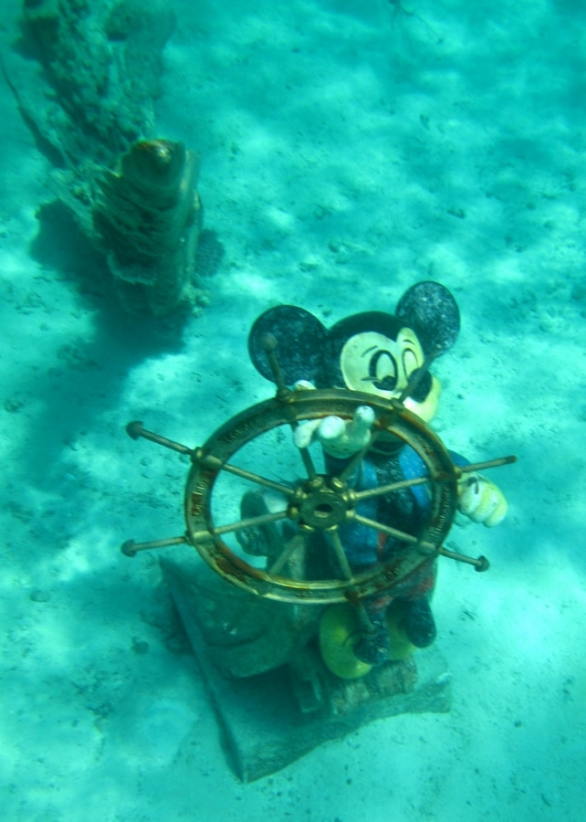 a Mickey Mouse statue under water