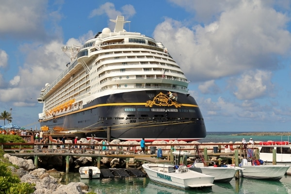 a view of the Disney Fantasy cruise ship in port from behind