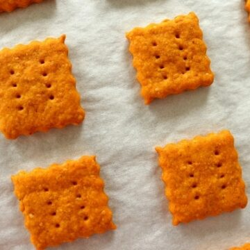 overhead closeup of homemade cheddar cheese crackers on a baking sheet