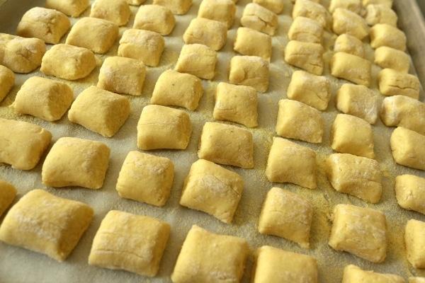 rows of cut gnocchi arranged on a baking sheet