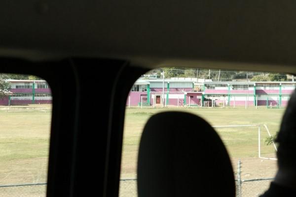 view of a school through a car window