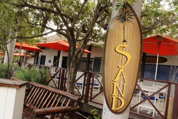 a restaurant sign that says Sand