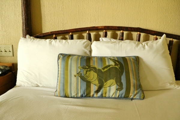 a bedroom accent pillow with an image of an alligator on it