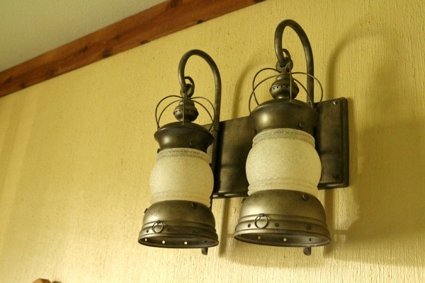lantern style lights hanging on a wall