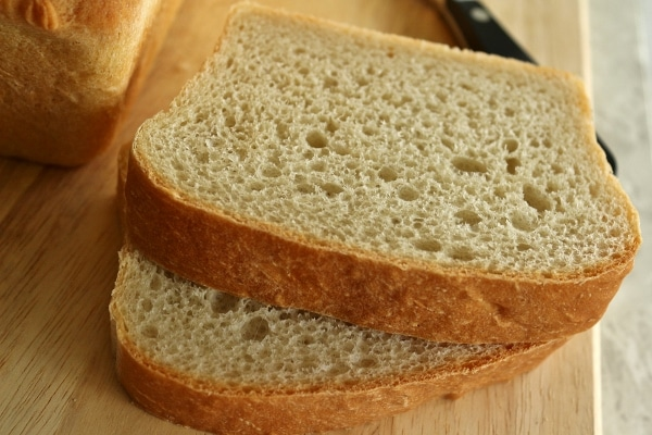 a closeup of sliced bread on a wooden board