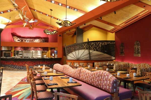 long banquette seating with tables and chairs inside Kona Cafe dining room