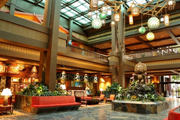 seating areas inside the Polynesian resort lobby with bright skylights and wooden decorations