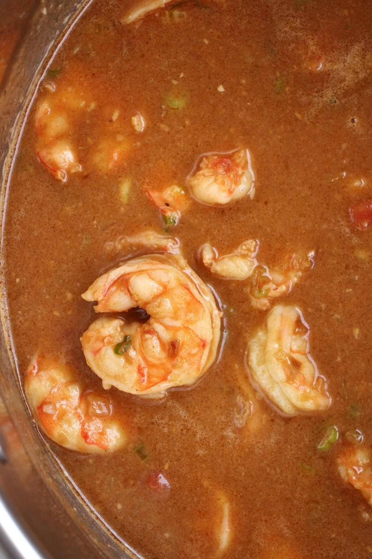 overhead view of a pot of shrimp in a thick creamy stew