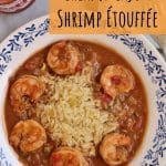 overhead view of a shallow white and blue bowl with rice and shrimp etouffee