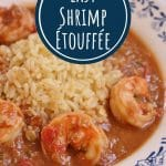 closeup of a shallow white bowl filled with rice and shrimp etouffee