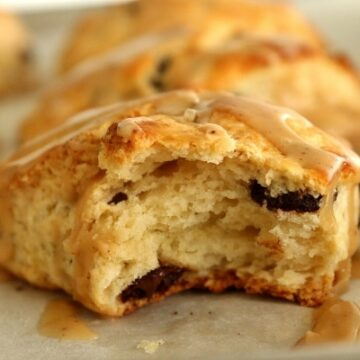 A close up of a half-eaten chocolate chip scone