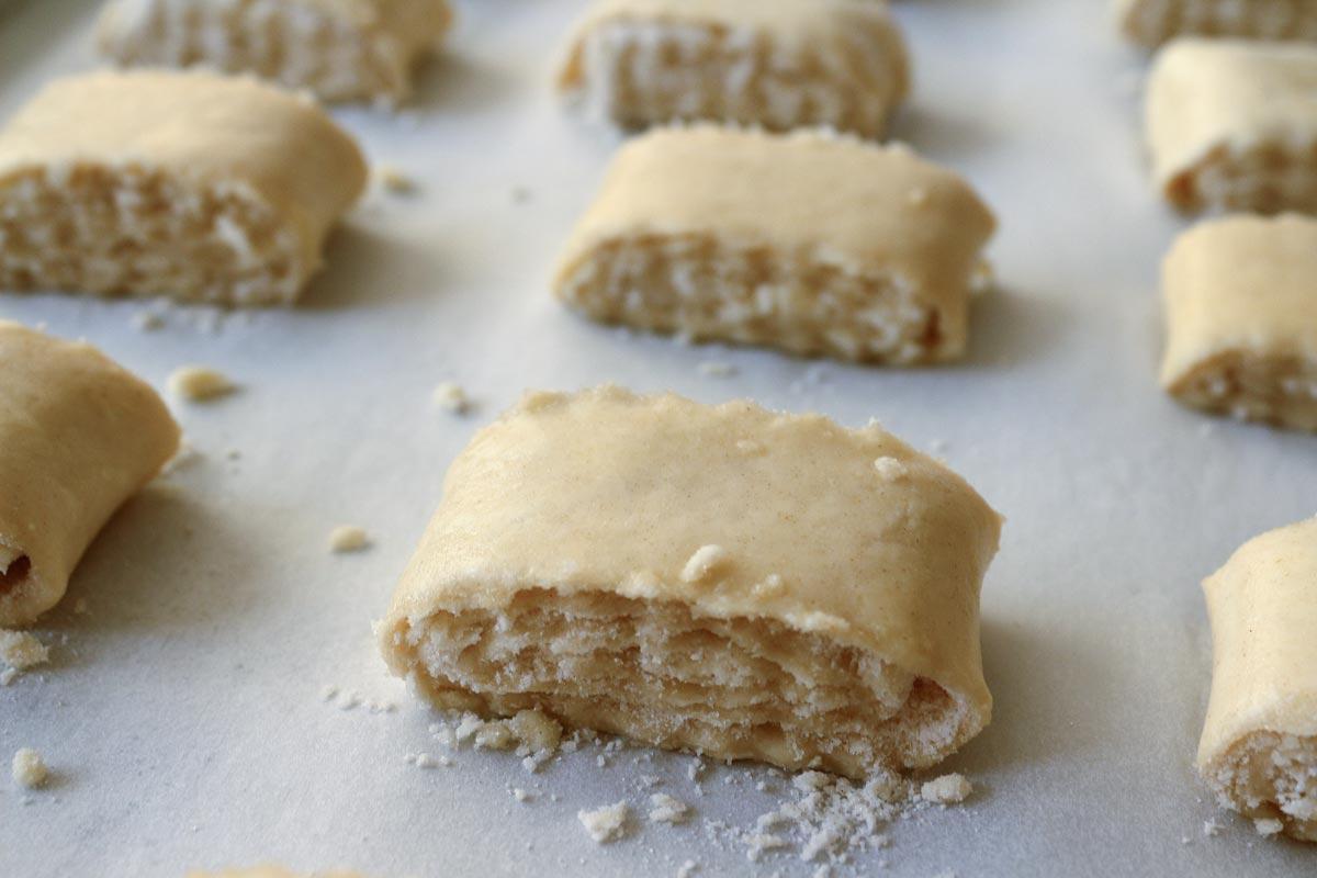 Unbaked gata arranged on a baking sheet.