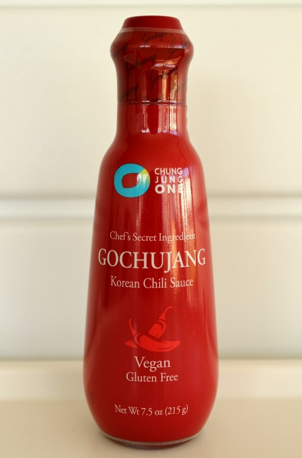 A close up of a bottle of Gochujang Korean chili sauce
