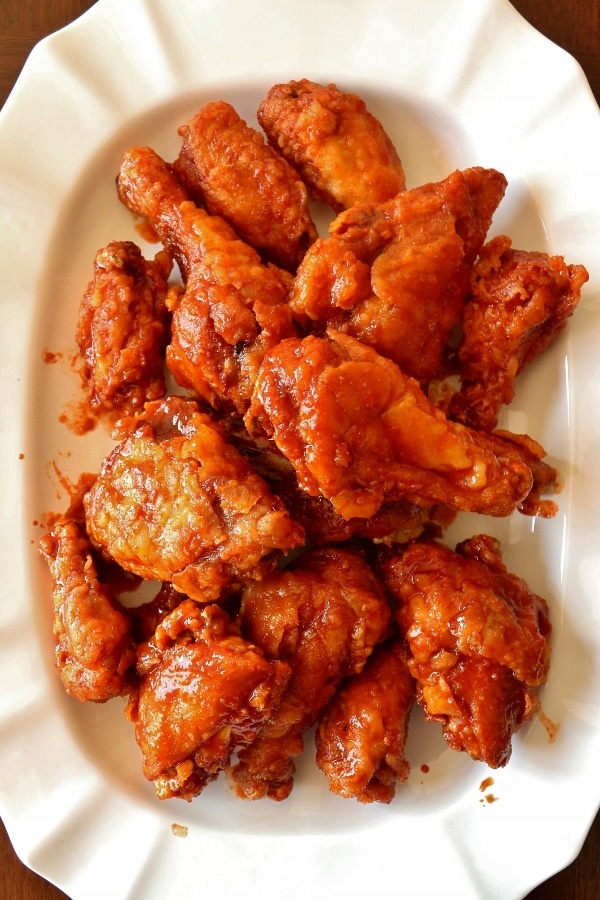 overhead view of a large white platter of Korean fried chicken