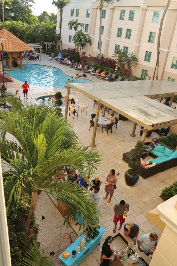 overhead view of people congregating outside a hotel pool
