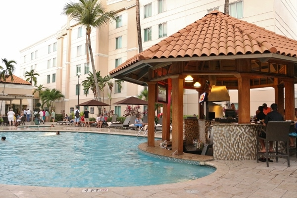 an outdoor swimming pool with a small bar and grill next to it