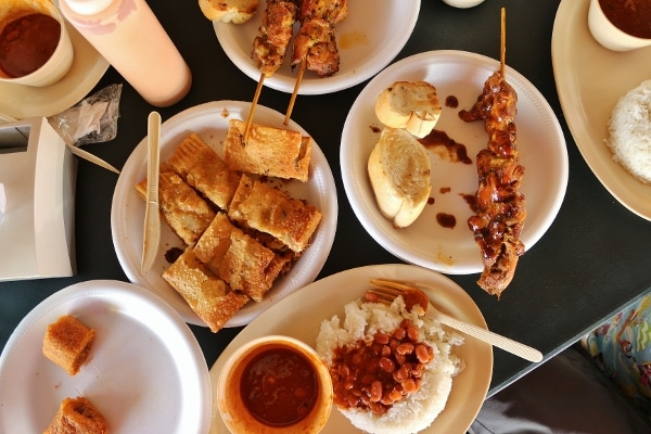 overhead view of a table covered with plates of Puerto Rican food