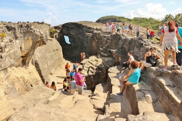 A group of people on a rocky landscape