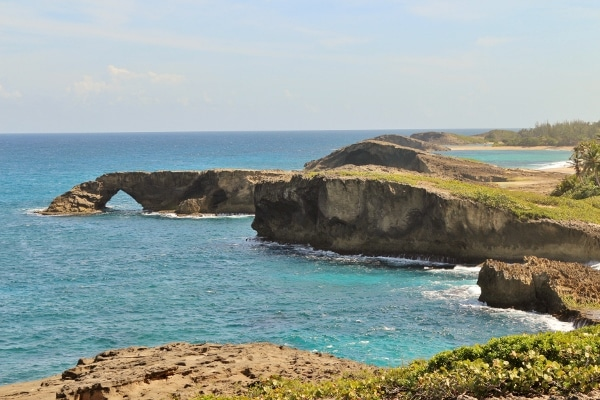 rocky arches in the distance along a shore