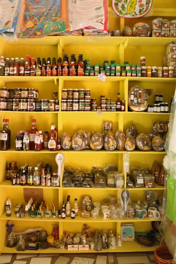 shelves of spices for sale in a shop