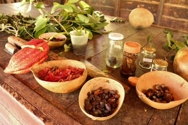 a variety of spices laid out on a wooden table