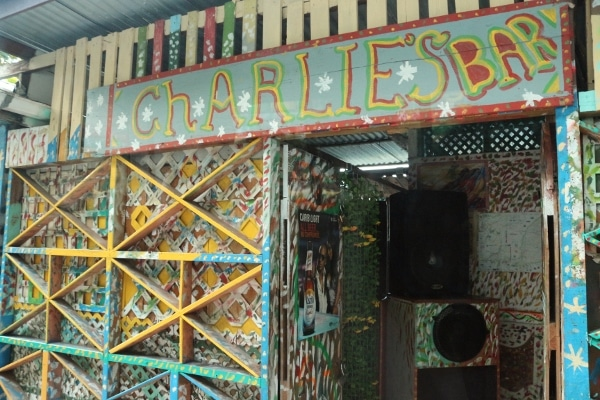 a colorful sign that says Charlie\'s Bar