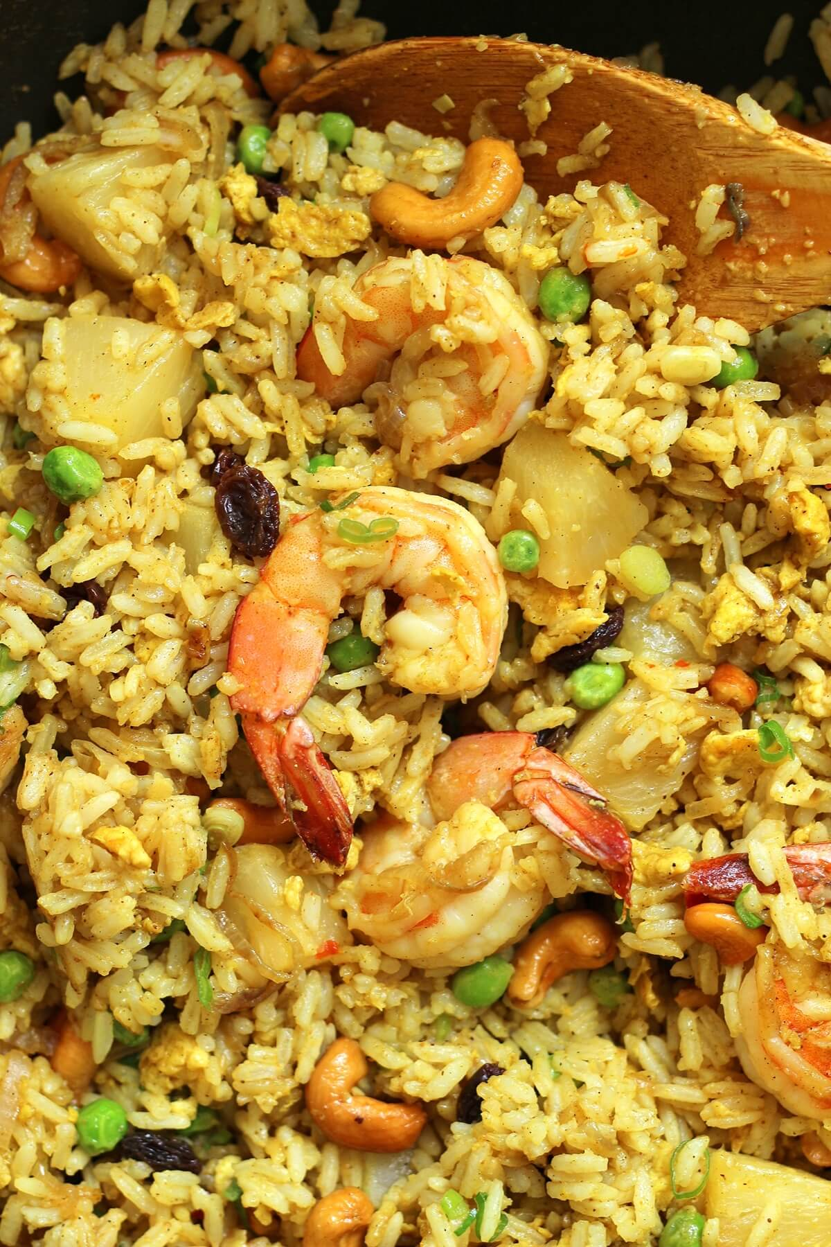 overhead view of pineapple fried rice with shrimp in a wok