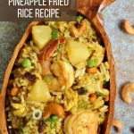 Thai pineapple fried rice with shrimp in a wooden bowl shaped like a pineapple
