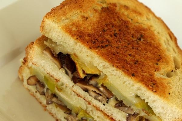 A sandwich cut in half on a white plate