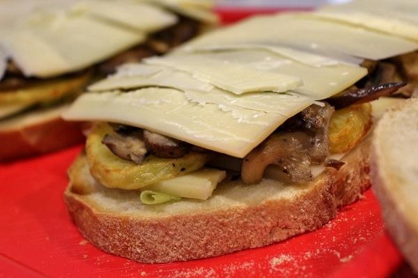 A close up of a half-assembled sandwich