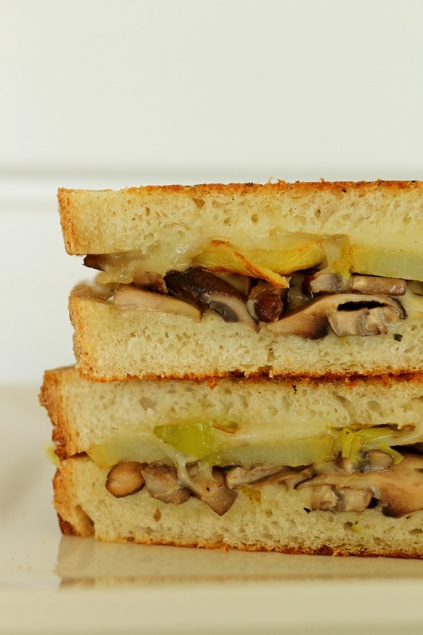 a closeup of a halved grilled cheese sandwich with mushroom and potato filling