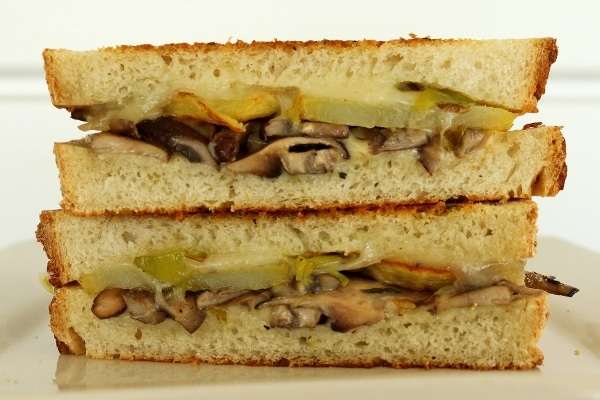a cross section of a mushroom and potato grilled cheese sandwich