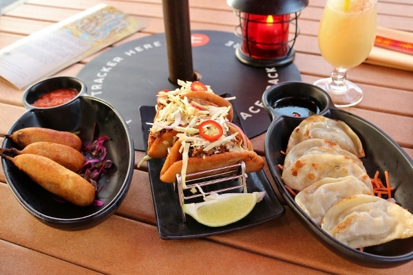 a variety of appetizers on an outdoor table