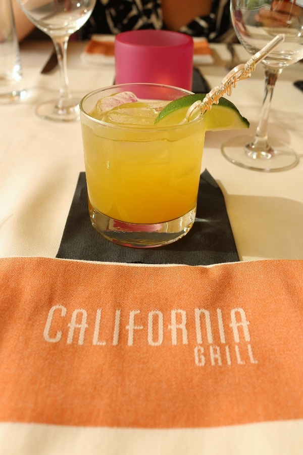 a cloth napkin that says California Grill and a cocktail in a glass