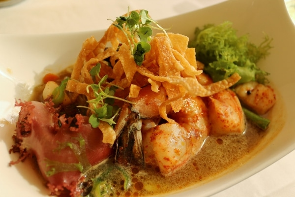 seafood topped with crispy wontons served over broth