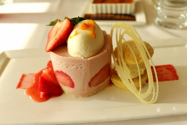a dessert made with strawberries and topped with a scoop of ice cream