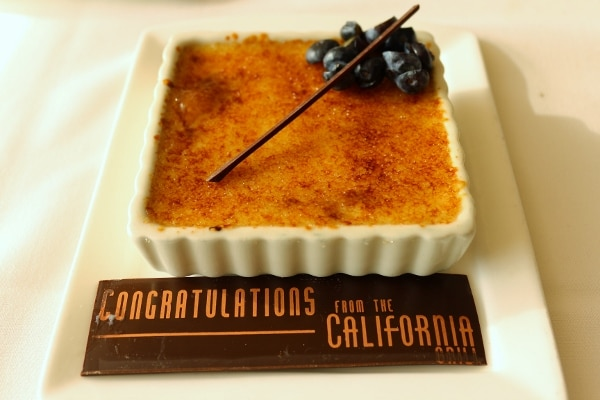 creme brulee in a square dish with a sign saying Congratulations from the California Grill
