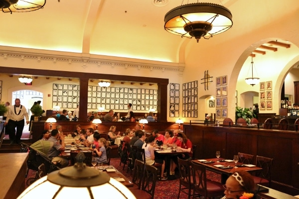 groups of people dining inside the dining room of a restaurant