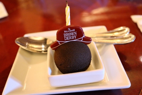 a chocolate truffle with a little hat that says The Hollywood Brown Derby