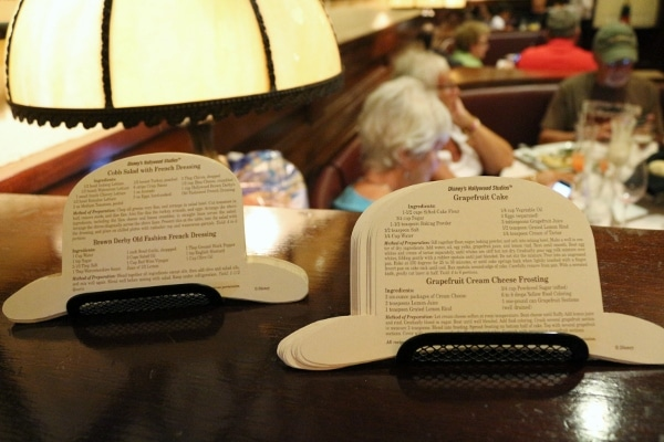 stacks of recipe cards on paper shaped like a hat