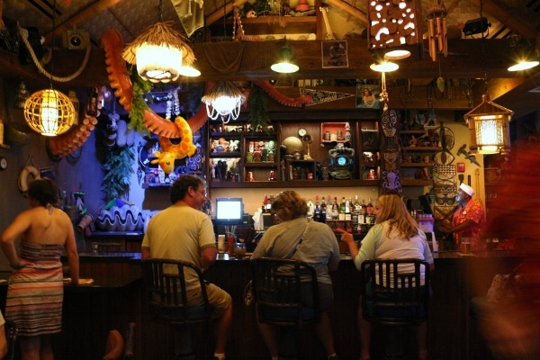 interior of a dark tiki bar with some nautical decorations