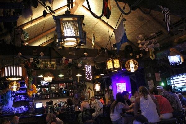 interior of a dimly lit tiki bar