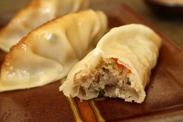 A close up of the filling in a chicken and thai basil dumpling