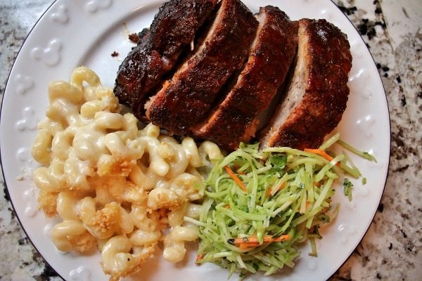 overhead view of a plate of ribs, mac and cheese, and slaw