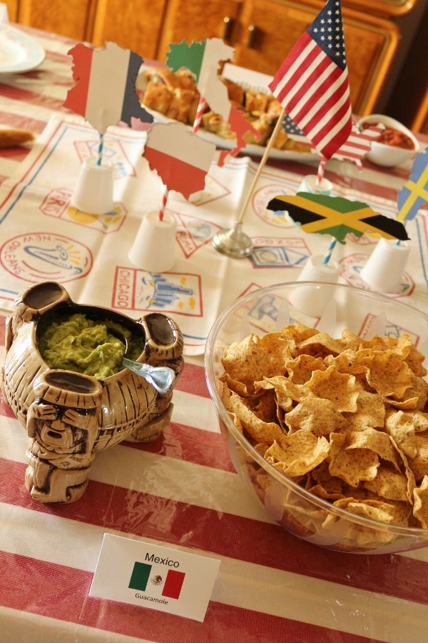 bowls of guacamole and chips on a table