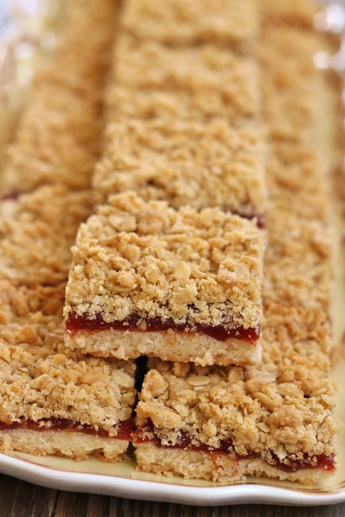 side view of a platter of guava bars with shortbread base and oat topping