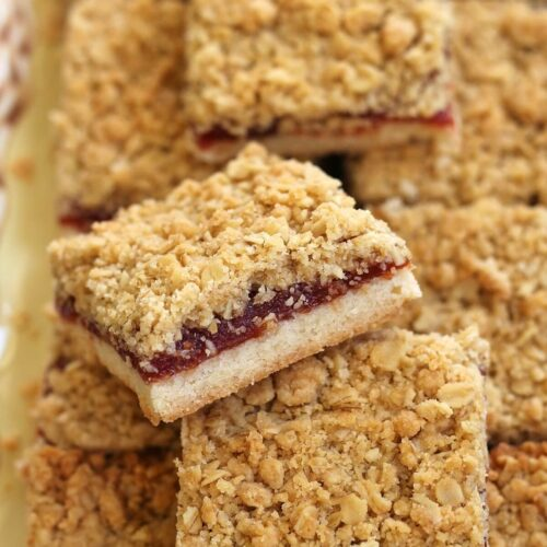 a platter of guava bars with crumbly oat topping