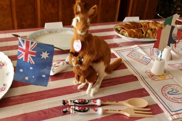 a kangaroo toy holding an Australian flag on a table